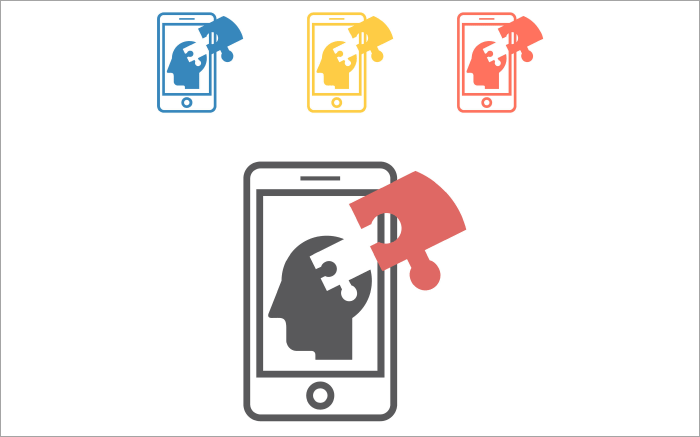 Mobile phone screen with a silhouette of a human head with a jigsaw puzzle piece being fitted into it