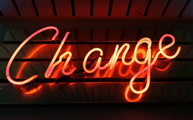 A neon sign reading Change