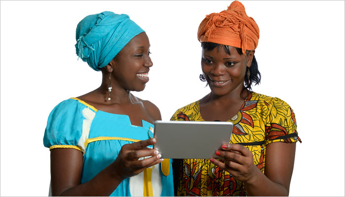 Two women sharing a tablet screen.